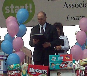 Justin-reads-proclamation-from-Governor-at-Diaper-Day